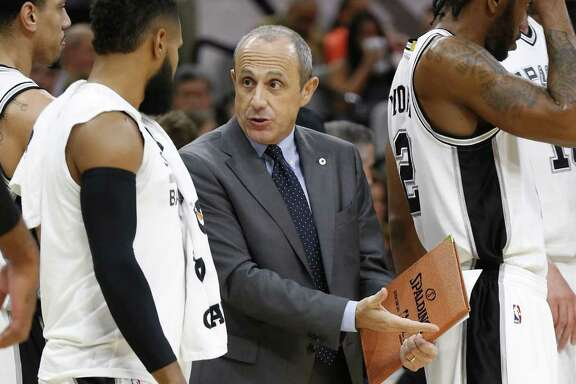 Spurs' assistant coach Ettore Messina (center) talks with Patty Mills (08) during the game against the Orlando Magic  at the AT&T Center on Tuesday, Nov. 29, 2016. (Kin Man Hui/San Antonio Express-News)