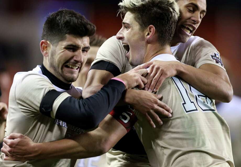 Wake Forest Ian Harkes (16) celebrates with teammates after scoring the game-winning goal during the second overtime against University of Denver at the 2016 NCAA soccer Men's College Cup semifinal game at BBVA Compass Stadium Friday, Dec. 9, 2016, in Houston. Harkes scored with an assist from Jon Bakero (7), left, who also made a goal during the first half of the game. The Demon Deacons beat the Pioneers 2-1. Photo: Yi-Chin Lee, Houston Chronicle / © 2016  Houston Chronicle