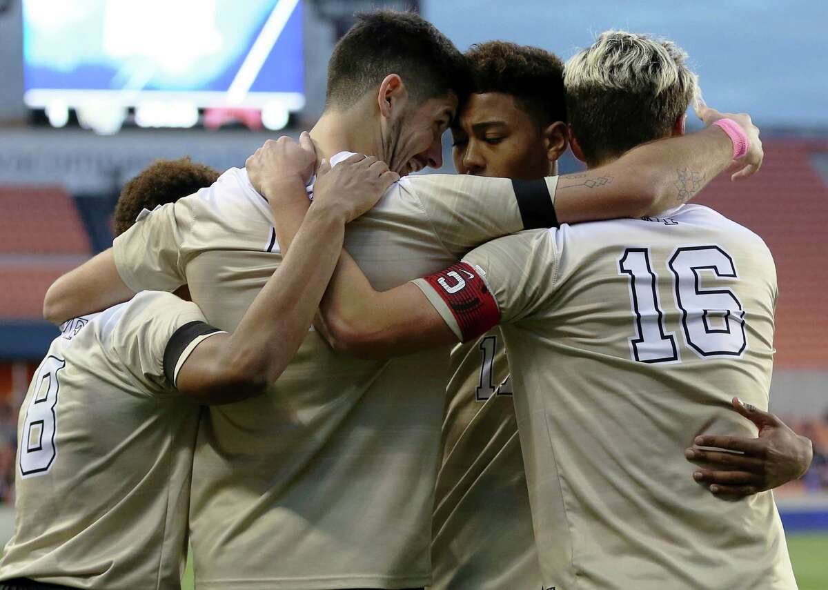 Wake Forest's Jon Bakero (7) celebrates with teammates after scoring during the first half of the NCAA soccer men's College Cup semifinal against Denver, Friday, Dec. 9, 2016, in Houston. (Yi-Chin Lee/Houston Chronicle via AP )