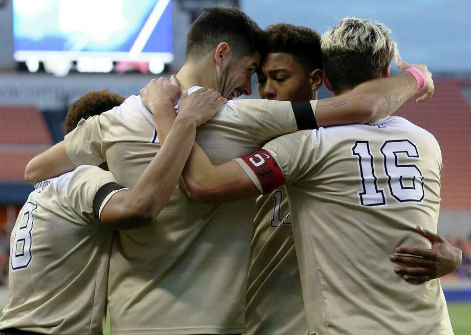 Wake Forest's Jon Bakero (7) celebrates with teammates after scoring during the first half of the NCAA soccer men's College Cup semifinal against Denver, Friday, Dec. 9, 2016, in Houston. (Yi-Chin Lee/Houston Chronicle via AP ) Photo: Yi-Chin Lee, Associated Press / ' 2016 Houston Chronicle