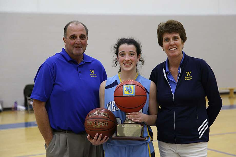 Westover School basketball player Gabbie Dunn of Watertown became the first player in school history to reach the 1,000-point milestone. She did so Dec. 2, 2016, in the first half of Westover's game against Chase Collegiate in the Tip Off Classic. Congratulating Dunn are her coach, Marty Pelosi, left, and Westover Athletic Director Tiz Mulligan. Photo: Contributed Photo / Contributed Photo