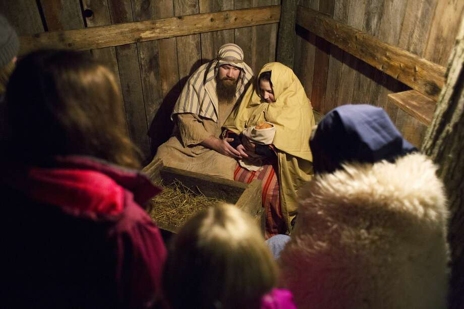 Richard and Tisha Reece, of Midland, portray Joseph and Mary, in Calvary Baptist's live nativity Friday evening. Photo: Theophil Syslo