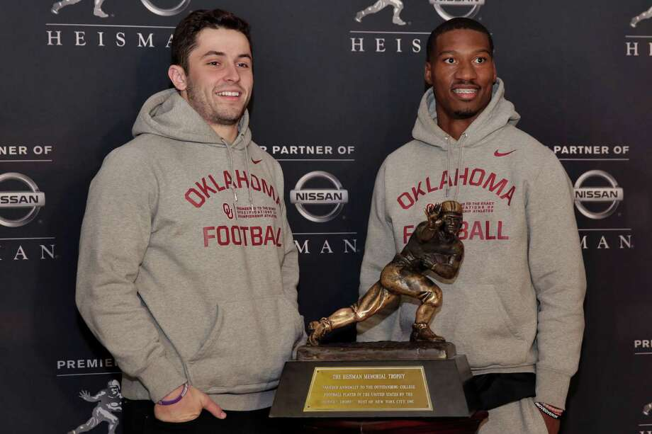 Heisman Trophy finalists from Oklahoma Baker Mayfield, left, and Dede Westbrook, pose with the award in New York, Friday, Dec. 9, 2016. (AP Photo/Richard Drew) ORG XMIT: NYRD115 Photo: Richard Drew / AP