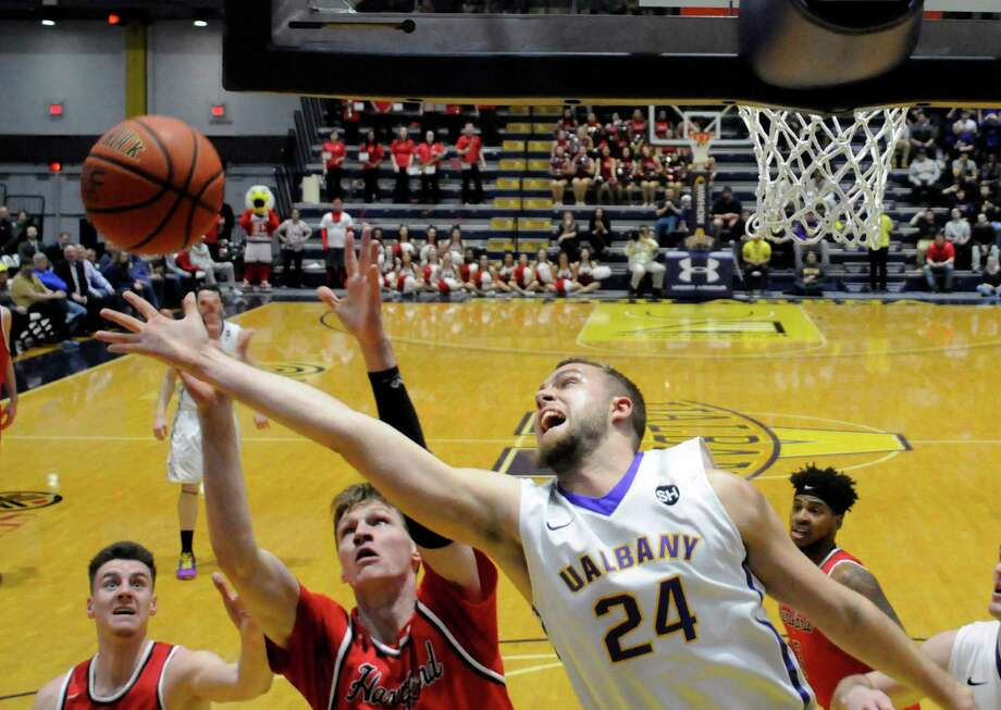 UAlbany's Dallas Ennema (24) grabs a rebound in front of Hartford players during the second half of an NCAA men's college basketball playoff game in the America East Conference on Wednesday, March 2, 2016, in Albany, N.Y. Hartford won the game 68-59. (Hans Pennink / Special to the Times Union) ORG XMIT: HP109 Photo: Hans Pennink / Hans Pennink