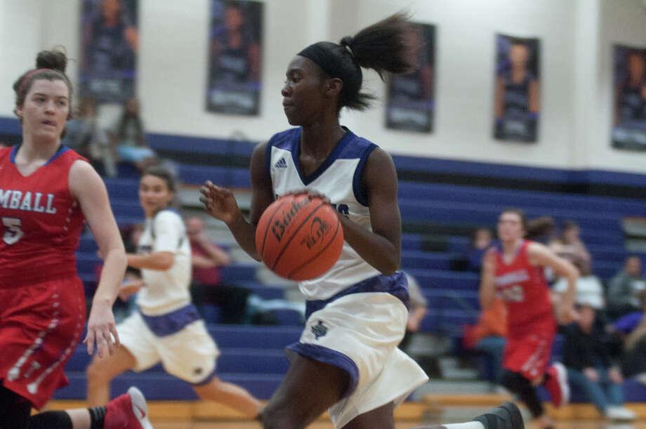 Willis guard Deseanna Murphy runs a fast break against Tomball on Friday at Willis High School. Photo: Keith MacPherson