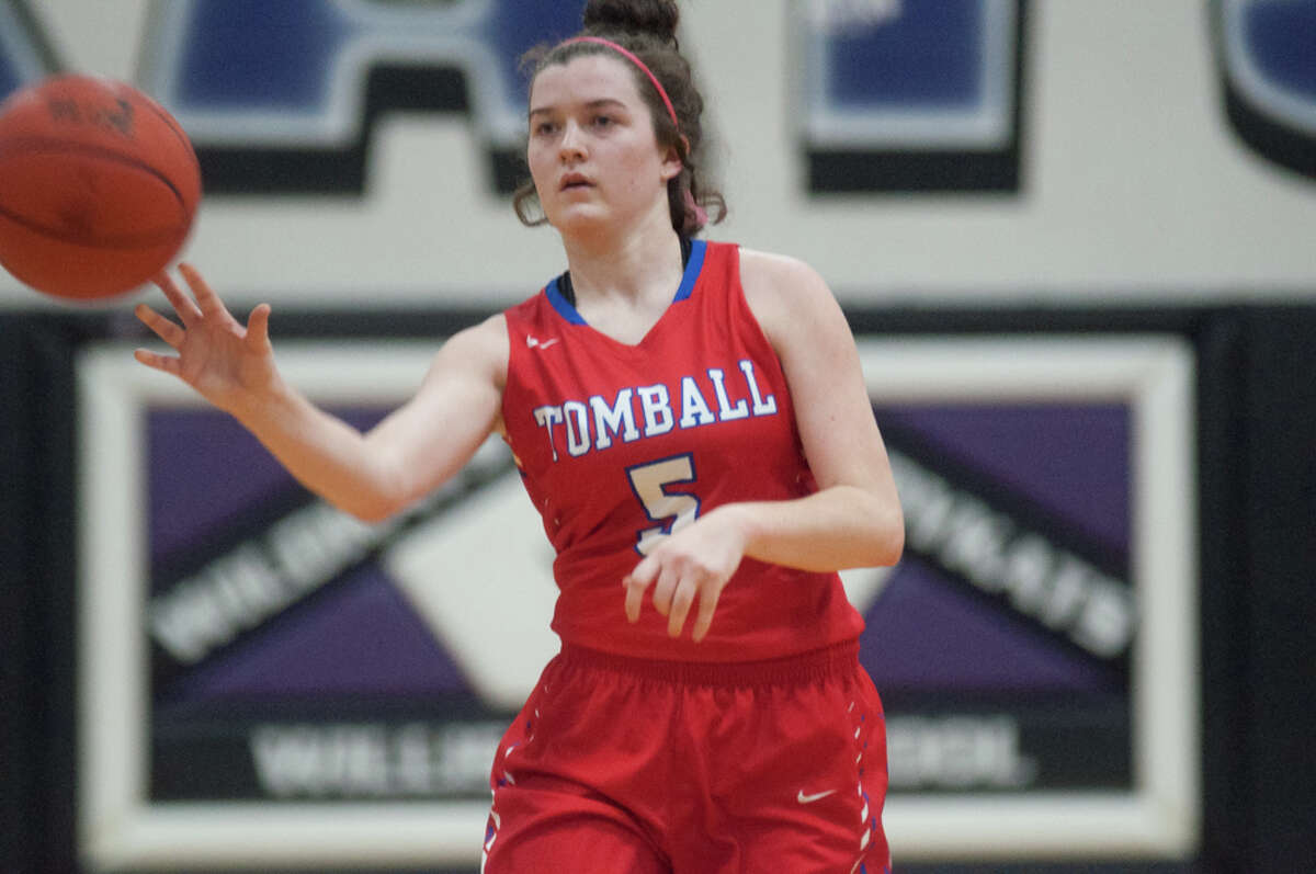 Tomball's Ashley Hailey passes the ball against Willis on Friday at Tomball High School.