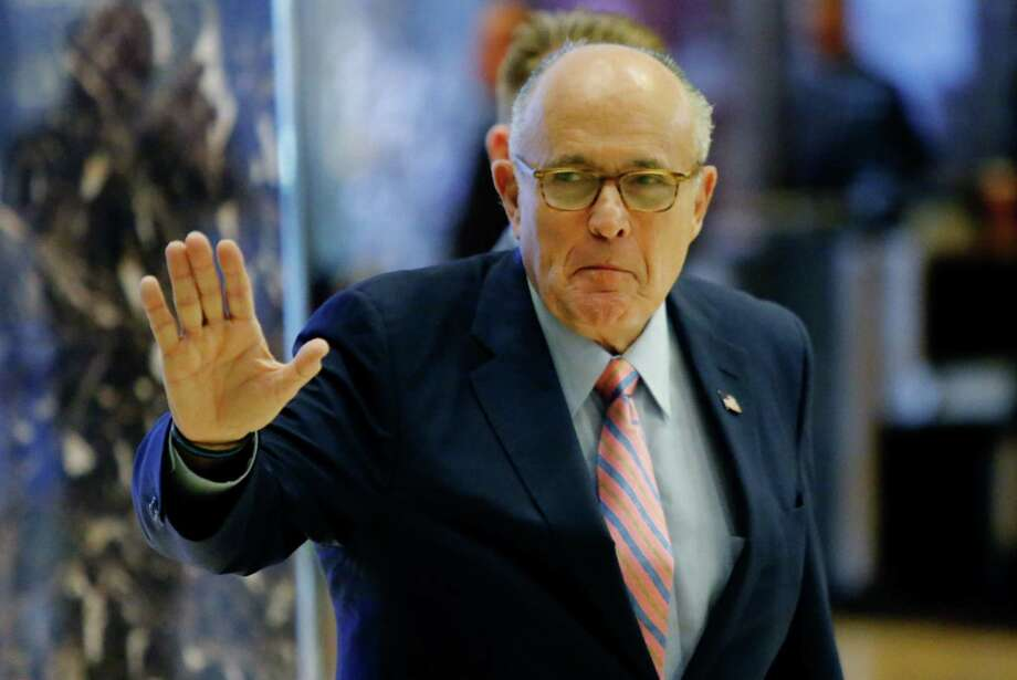 (FILES) This file photo taken on November 17, 2016 shows  former New York City Mayor Rudy Giuliani arrives at the Trump Tower for meetings with US President-elect Donald Trump in New York. Trump announced on December 9, 2016, that  Giuliani, a key surrogate on the campaign trail, would not join his incoming administration after he takes office next month. / AFP PHOTO / Eduardo Munoz AlvarezEDUARDO MUNOZ ALVAREZ/AFP/Getty Images Photo: EDUARDO MUNOZ ALVAREZ, Stringer / AFP or licensors