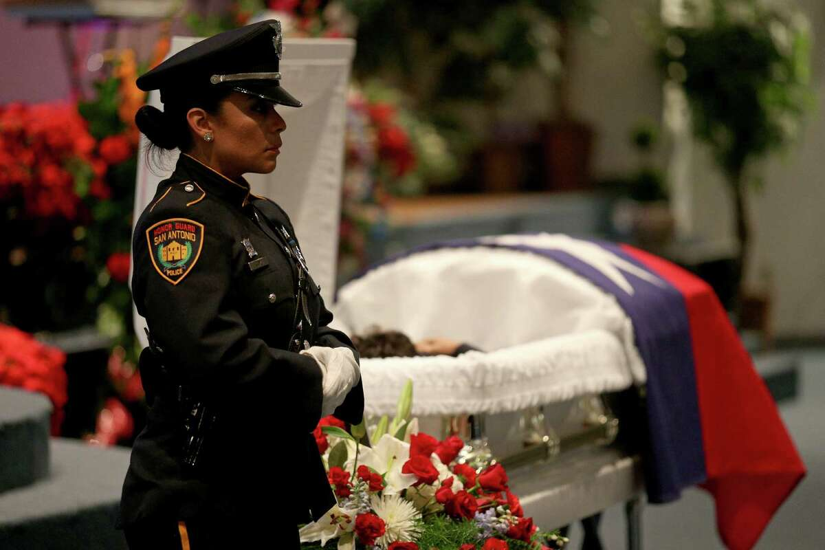 San Antonio Police Department Honor Guard Detective Yvette Coz stands at attention near the casket of Bexar County Sheriff's Office Deputy Doralinda Solis Nishihara during the public viewing held Friday Dec. 9, 2016 at Sendero Assembly of God Church. BCSO Deputy Doralinda Solis Nishihara died after driving her vehicle into a large sinkhole Sunday evening on the Southwest Side.
