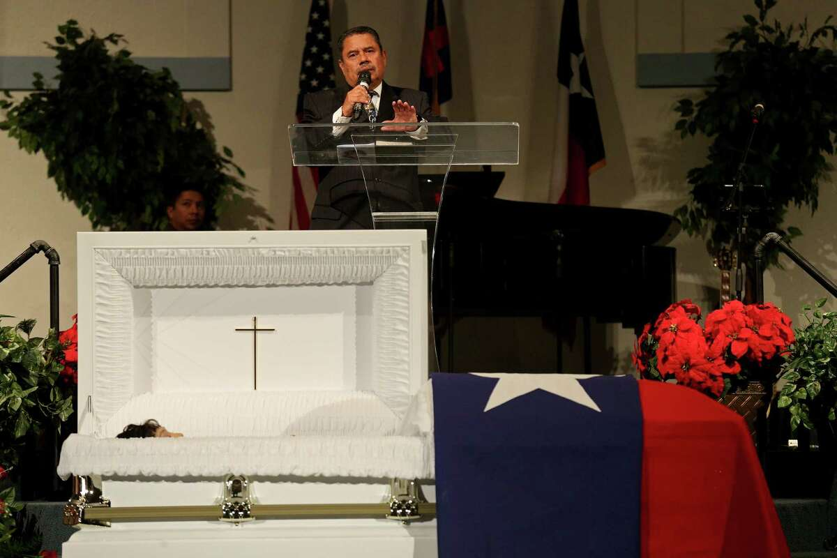 Pastor Israel Solis leads the funeral service for his sister Bexar County Sheriff's Office Deputy Doralinda Solis Nishihara held Friday Dec. 9, 2016 at Sendero Assembly of God Church. BCSO Deputy Doralinda Solis Nishihara died after driving her vehicle into a large sinkhole Sunday evening on the Southwest Side.