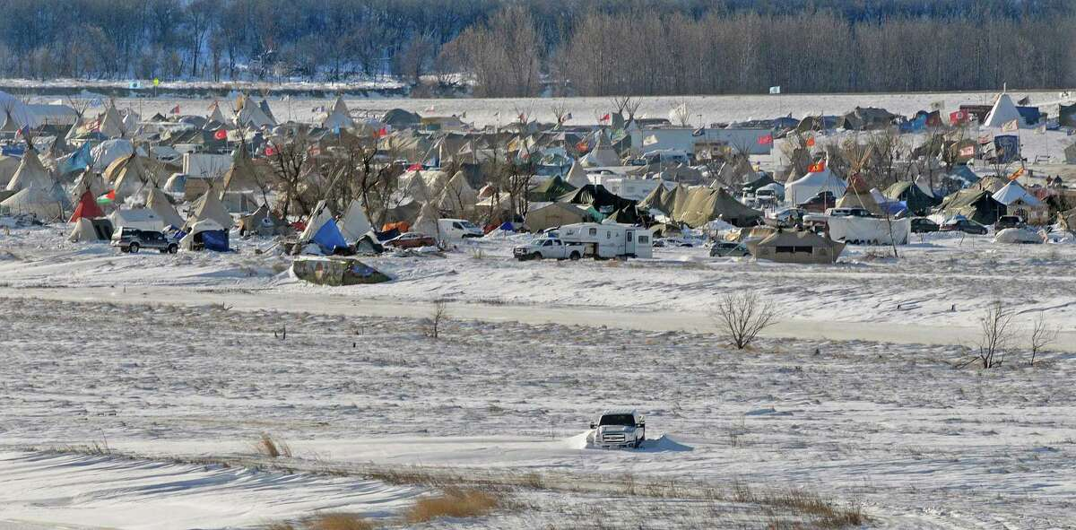 Despite extreme weather conditions the protest camp near Cannon Ball, North Dakota still has an estimated 2000 people who oppose the Dakota Access Pipeline. This photograph taken Thursday, Dec. 8, 2016 shows part of the encampment that has endured a prairie blizzard and subzero temperatures in the past week. People at the camp are asking that no new people come to visit or stay due to conditions but those presently there plan to keep a presence at the remote site. /The Bismarck Tribune via AP)