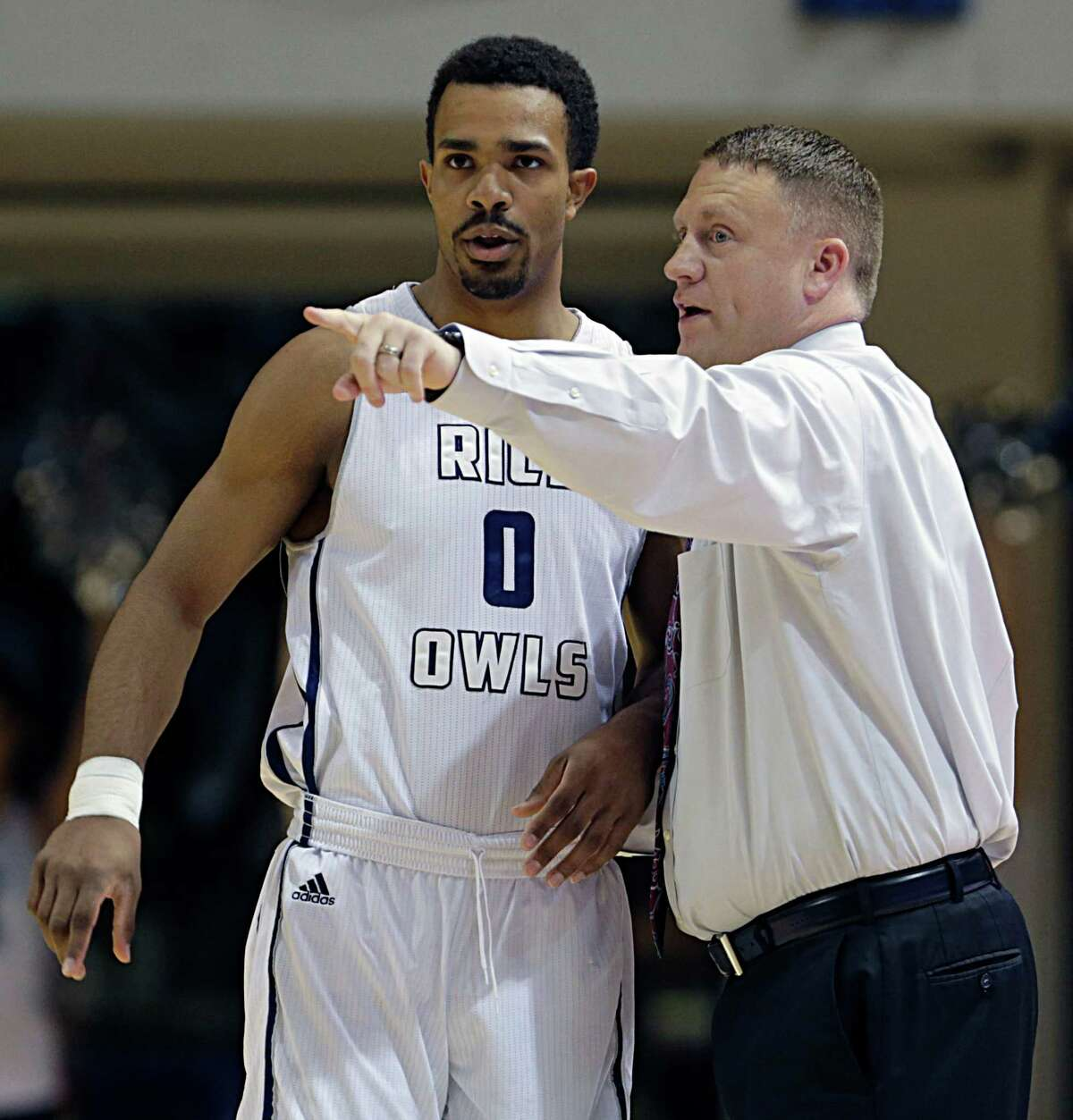 Rice guard Connor Cashaw left, and Rice head coach Mike Rhoades during the first half of men's college basketball game action against Houston Baptist at Tudor Fieldhouse Nov. 30, 2016, in Houston. ( James Nielsen / Houston Chronicle )