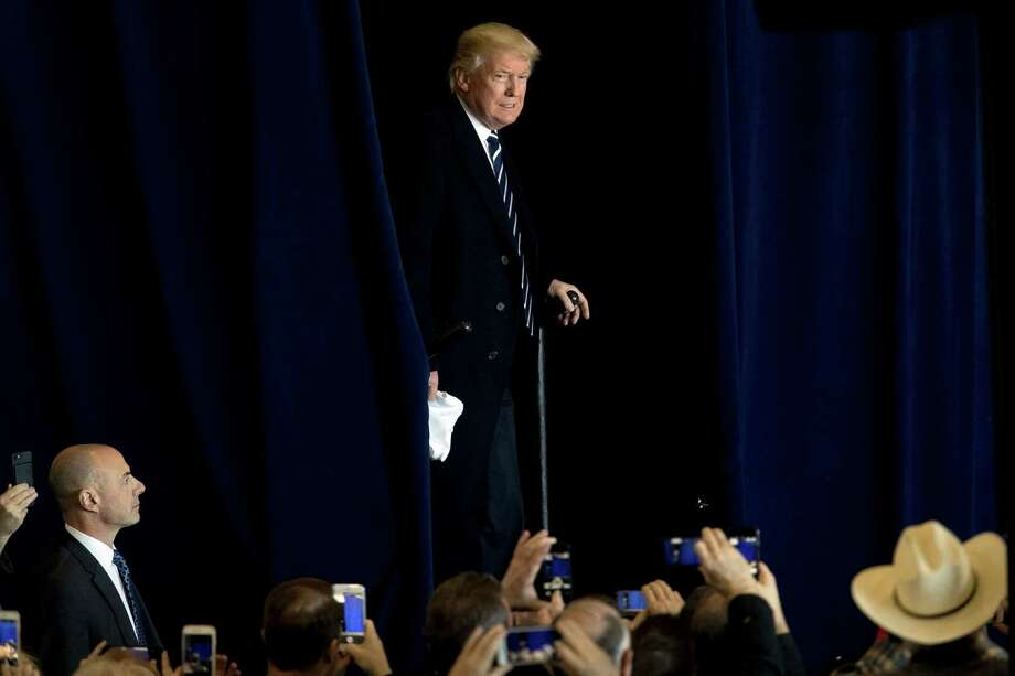 President-elect Donald Trump arrives for a rally in a DOW Chemical Hanger at Baton Rouge Metropolitan Airport, Friday, Dec. 9, 2016, in Baton Rouge, La. (AP Photo/Andrew Harnik) ORG XMIT: LAAH114 Photo: Andrew Harnik / Copyright 2016 The Associated Press. All rights reserved.