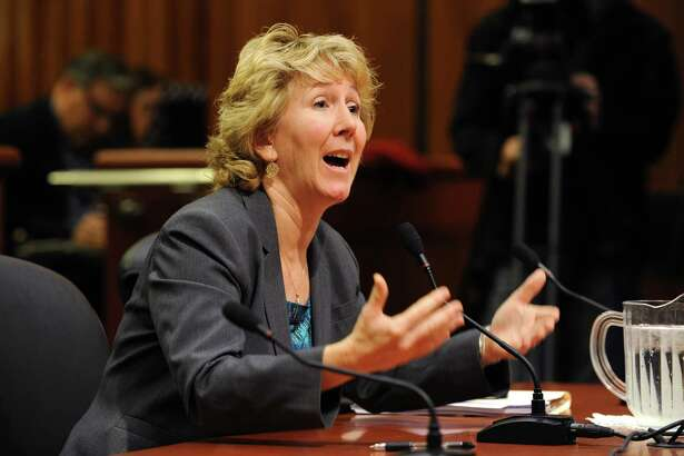 Karen Murtagh, Executive Director, Prisoners Legal Services, left, answers a question as the Assembly Corrections Committee holds a hearing on oversight and investigations of the Department of Corrections at the Legislative Office Building on Wednesday Dec. 2, 2015 in Albany, N.Y.  (Lori Van Buren / Times Union)