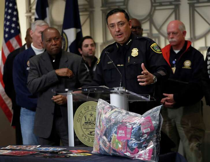 Police Chief Art Acevedo, center, and Mayor Sylvester Turner announce the arrests on Friday.