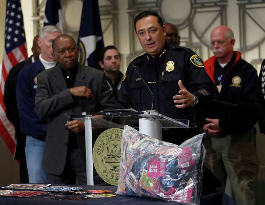 Police Chief Art Acevedo, center, and Mayor Sylvester Turner announce the arrests on Friday. Photo: Karen Warren, Staff Photographer / 2016 Houston Chronicle