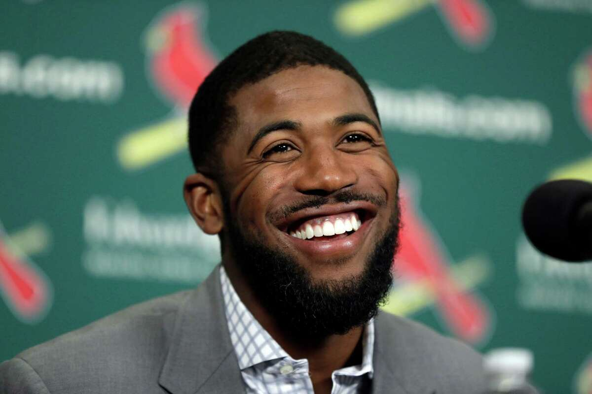 Dexter Fowler smiles during an introductory news conference announcing the free agent center fielder has signed with the St. Louis Cardinals Friday, Dec. 9, 2016, in St. Louis. (AP Photo/Jeff Roberson)