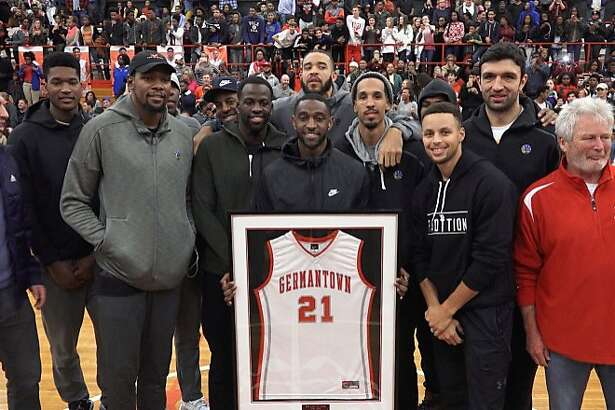 Warriors guard Ian Clark had his jersey returned Friday at Germantown High School in Germantown, Tenn. Many of his Golden State teammates attended the ceremony.