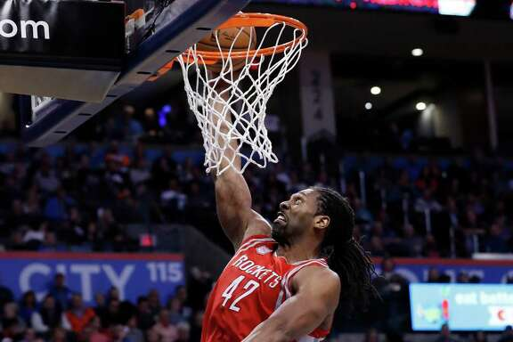Houston Rockets center Nene Hilario (42) goes up for a dunk over Oklahoma City Thunder guard Russell Westbrook (0) during the first half of an NBA basketball game in Oklahoma City, Friday, Dec. 9, 2016. (AP Photo/Alonzo Adams)