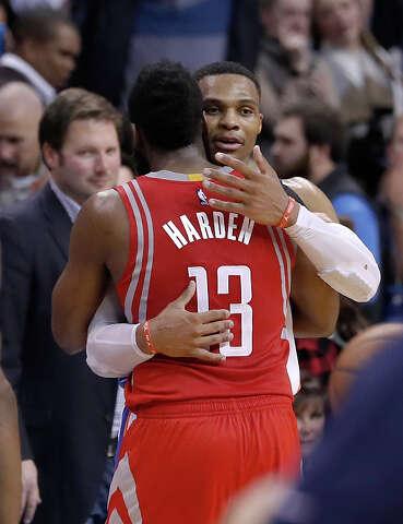3dd10e21858 Oklahoma City Thunder guard Russell Westbrook (0) meets Houston Rockets  guard James Harden (