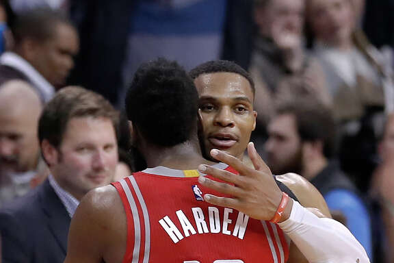 Oklahoma City Thunder guard Russell Westbrook (0) meets Houston Rockets guard James Harden (13) at the end of an NBA basketball game in Oklahoma City, Friday, Dec. 9, 2016. Houston won 102-99. (AP Photo/Alonzo Adams)