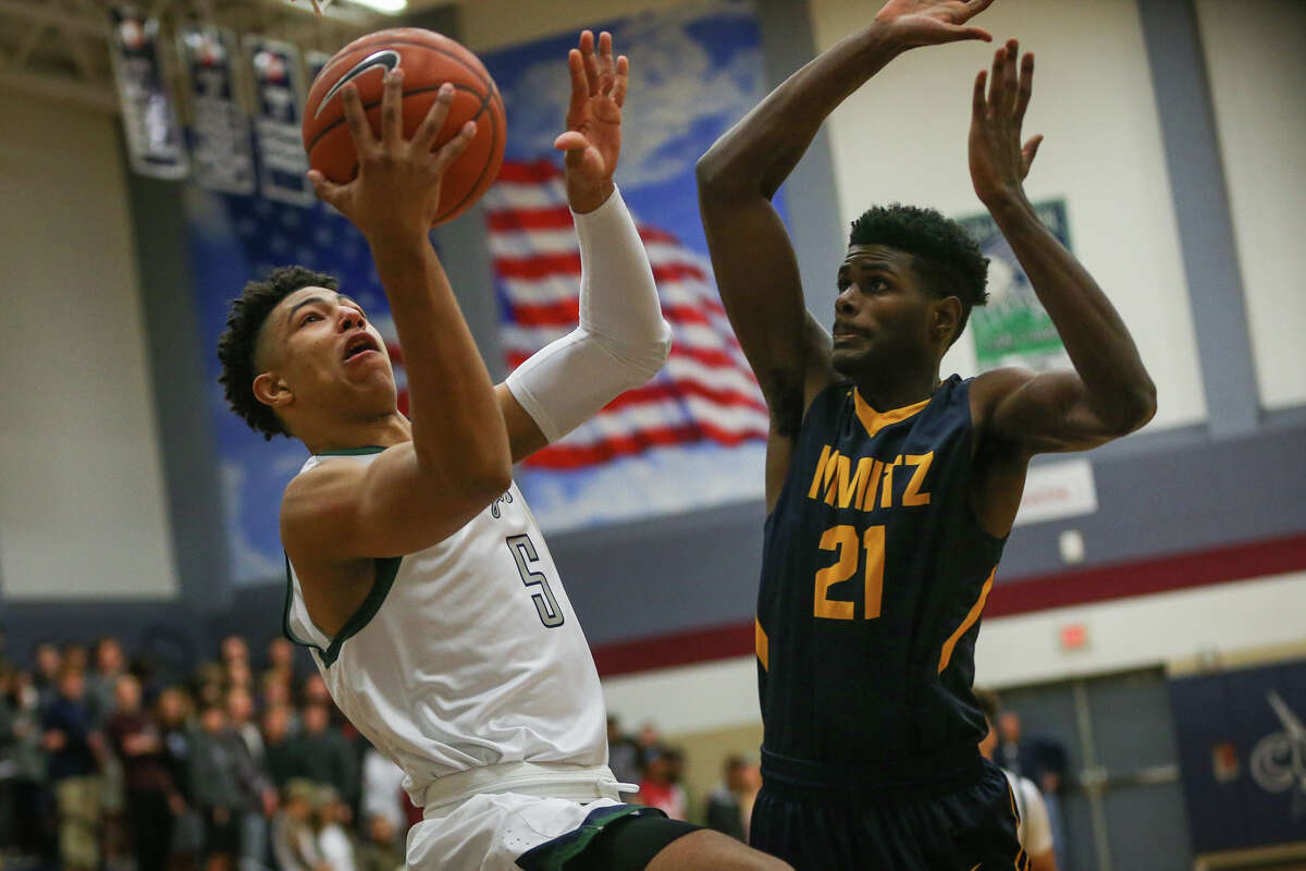 College Park's Quentin Grimes (5) shoots as Nimitz's Byron Taylor (21) defends during the varsity boys basketball game on Friday, Dec. 9, 2016, at College Park High School. (Michael Minasi / Chronicle)
