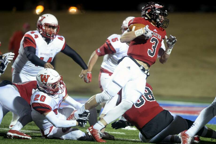 Iraan's Kyle Obannon (3) is tripped up near the end zone by Wellington's Weston Wright (20) in the Class 2A Division II state semifinal game Friday, Dec. 9, 2016, at Shotwell Stadium in Abilene. James Durbin/Reporter-Telegram Photo: James Durbin