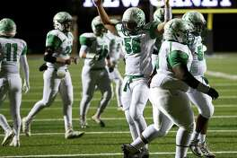 Boling offensive lineman Robert Sanchez (58) celebrates a touchdown by running back Elijah Gooden (22) to take the lead during the fourth quarter of the Class 3A, Division II state semifinals, at Texan Drive Stadium, Friday, Dec. 9, 2016, in Porter.