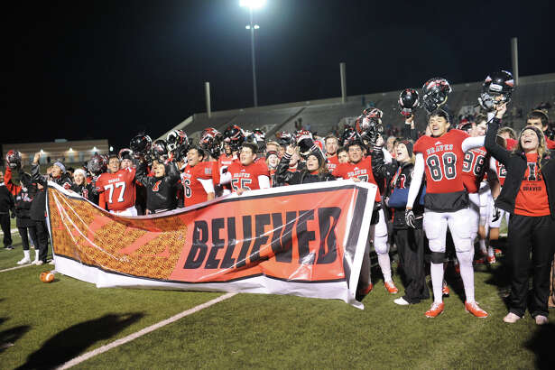 Iraan football players and cheerleaders celebrate a win against Wellington in the Class 2A Division II state semifinal game Friday, Dec. 9, 2016, at Shotwell Stadium in Abilene.  James Durbin/Reporter-Telegram