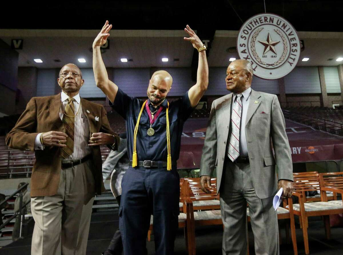 TSU valedic-torian Renald Moore, center,  with James Cunningham, right, an education professor, and Bobby Wilson, vice president for academic affairs.