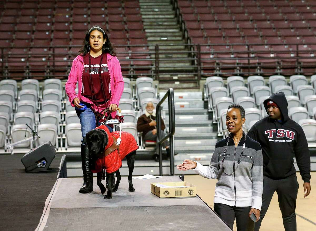 """Ana Cepeda helps her guide dog """"Calliope"""" practice walking across the stage during a graduation rehearsal on Thursday. Crossing the stage with only her service animal has been one of Cepeda's dreams."""