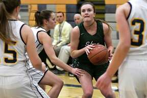 Shen's Meghan Gillooley, center, controls the ball during their basketball game against Averill Park on Friday, Dec. 9, 2016, at Averill Park High in Averill Park, N.Y. (Cindy Schultz / Times Union)