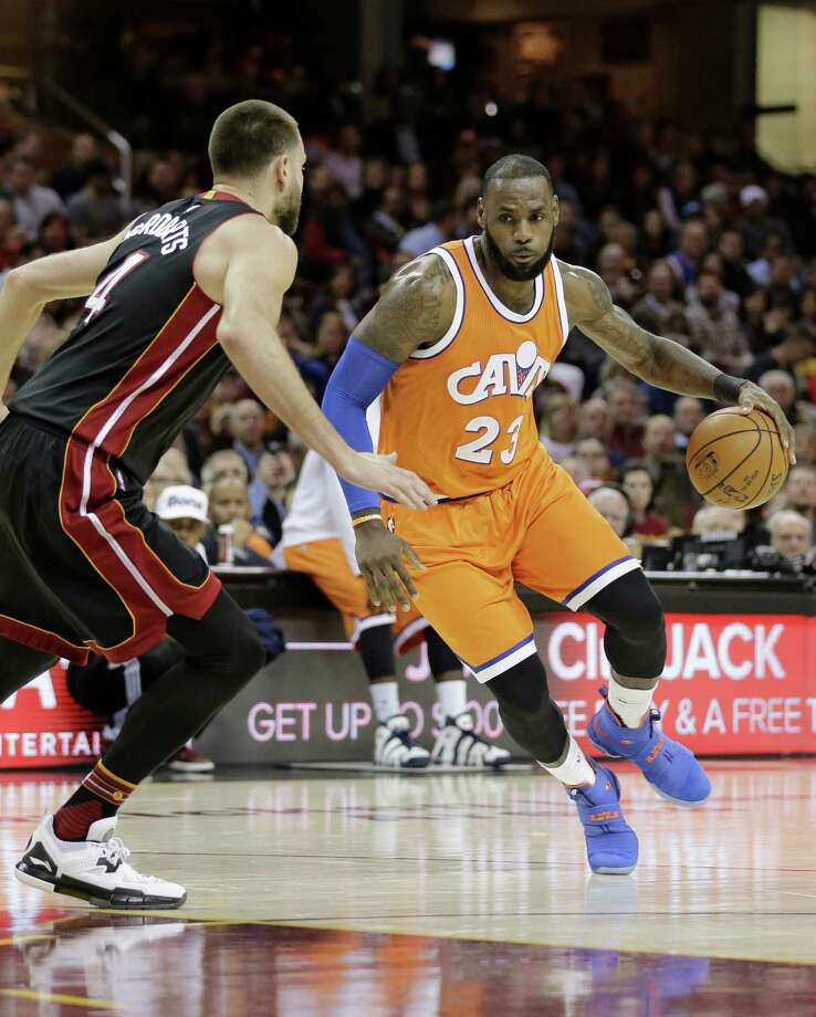Cleveland Cavaliers' LeBron James (23) drives past Miami Heat's Josh McRoberts (4) in the first half of an NBA basketball game Friday, Dec. 9, 2016, in Cleveland. (AP Photo/Tony Dejak) ORG XMIT: OHTD102 Photo: Tony Dejak / AP 2016