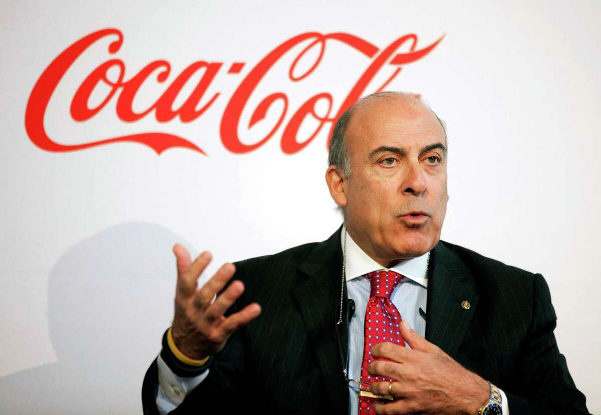 FILE - In this May 8, 2013 file photo, Coca-Cola CEO Muhtar Kent speaks during a news conference in Atlanta. Coca-Cola said Friday, Dec. 9, 2016 that Kent will step down as CEO next year and be replaced by Chief Operating Officer James Quincey. (AP Photo/David Goldman, File)