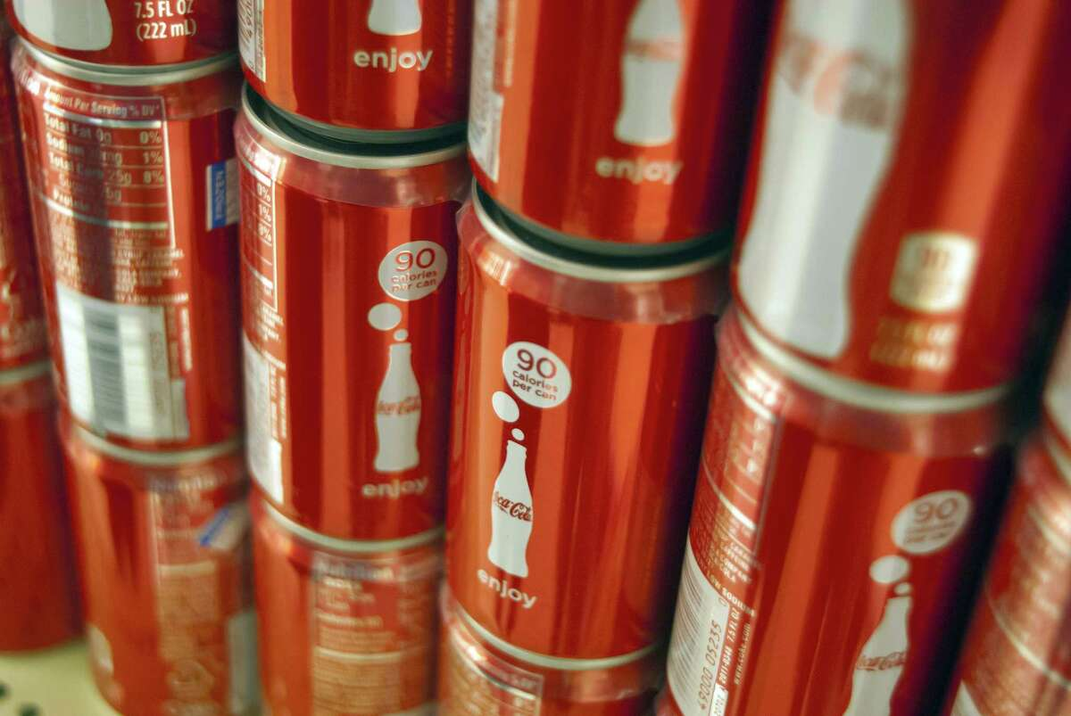 """Coke's """"mini"""" can appeals to people who want to drink less soda for health or weight-loss reasons, while netting the company more money. The next CEO of Coca-Cola says he'll also keep pushing for more low-calorie beverages."""