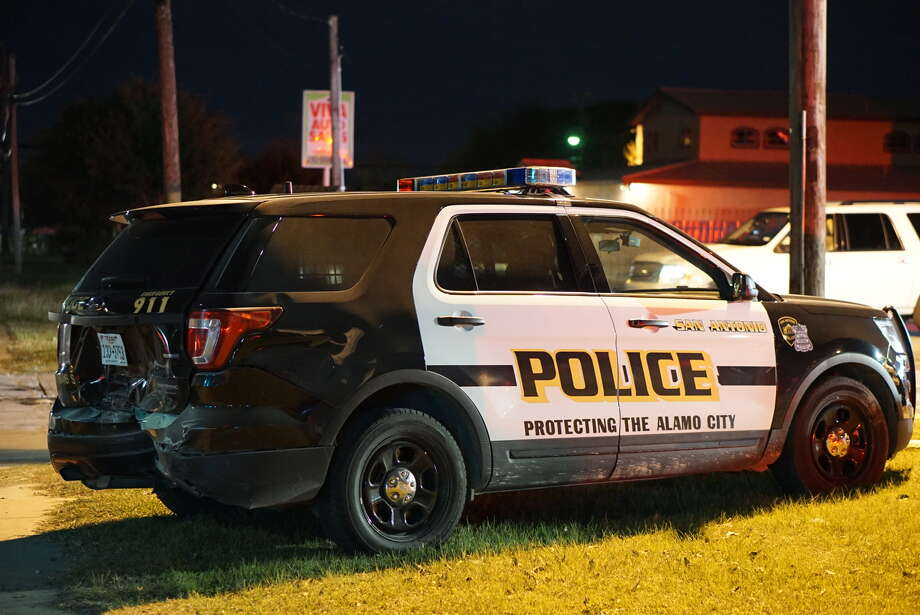 Two San Antonio police officers were injured after one rear-ended the other while arriving on the scene Friday night on the South Side. Photo: Jacob Beltran