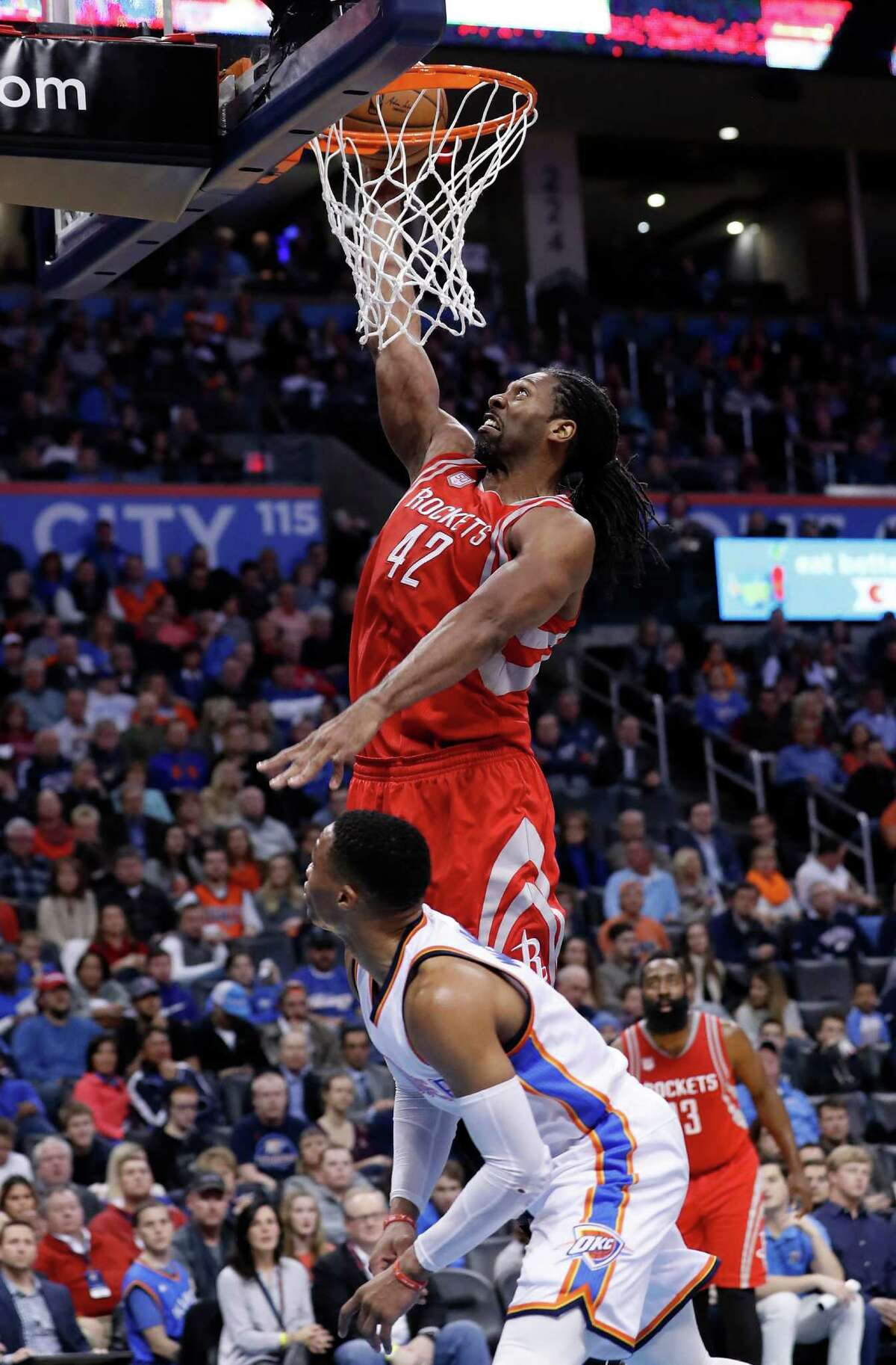 Rockets center Nene goes up for a dunk over Thunder guard Russell Westbrook during the first half Friday night. Nene finished with 11 points.