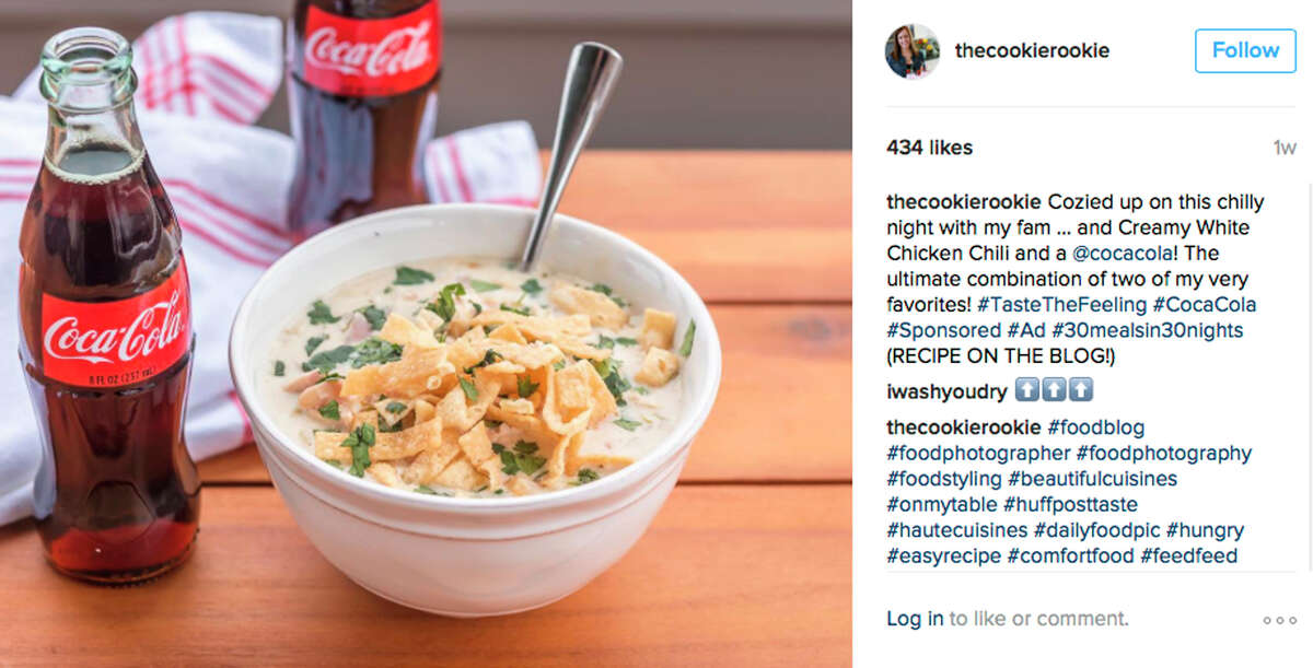 This image provided by Vox Media shows a social media post featuring Coca-Cola next to chicken chili. Coca-Cola is trying to sell more of its flagship beverage by suggesting it can accompany a wide range of meals.