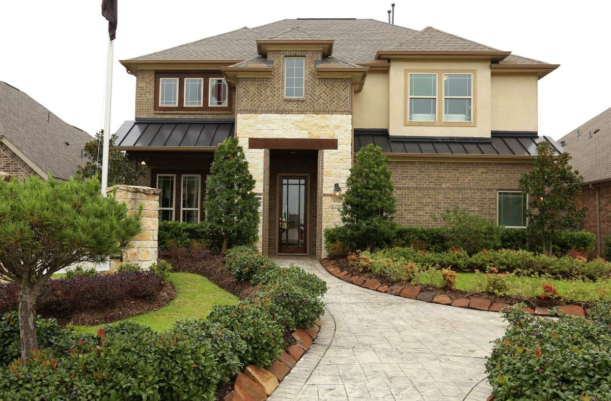 Potential homebuyers can look over this Gehan Homes model on a 50-foot lot in the Hidden Lakes community in League City.