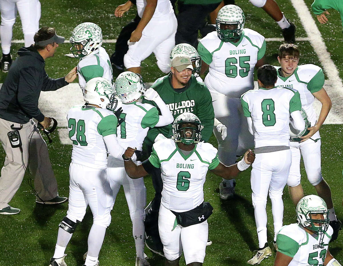 Boling quarterback Vernon Jackson (6), center, celebrates after intercepting a pass to seal the victory over the Arp Tigers during the fourth quarter of the Class 3A, Division II state semifinals, at Texan Drive Stadium, Friday, Dec. 9, 2016, in Porter. ( Jon Shapley / Houston Chronicle )