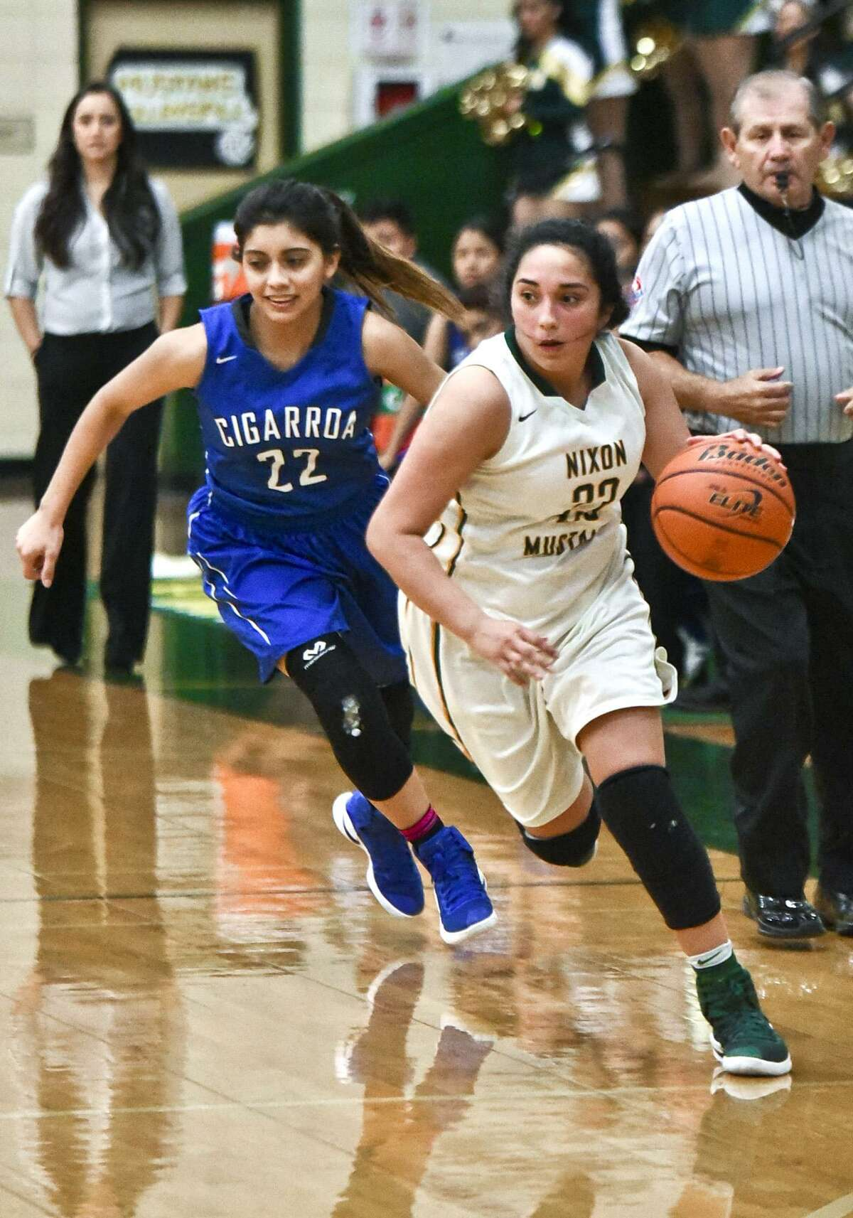 Cigarroa High School Larissa Palomares chases after Nixon High School Kassy Lazcano on Friday night during a game at Nixon High School.
