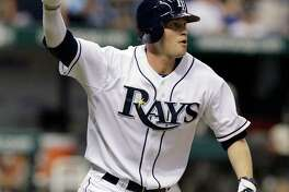 Tampa Bay Rays' Reid Brignac raises his fist after hitting an 11th-inning home run off New York Yankees relief pitcher Sergio Mitre during a baseball game Monday, Sept. 13, 2010, in St. Petersburg, Fla. The Rays won the game 1-0. (AP Photo/Chris O'Meara)
