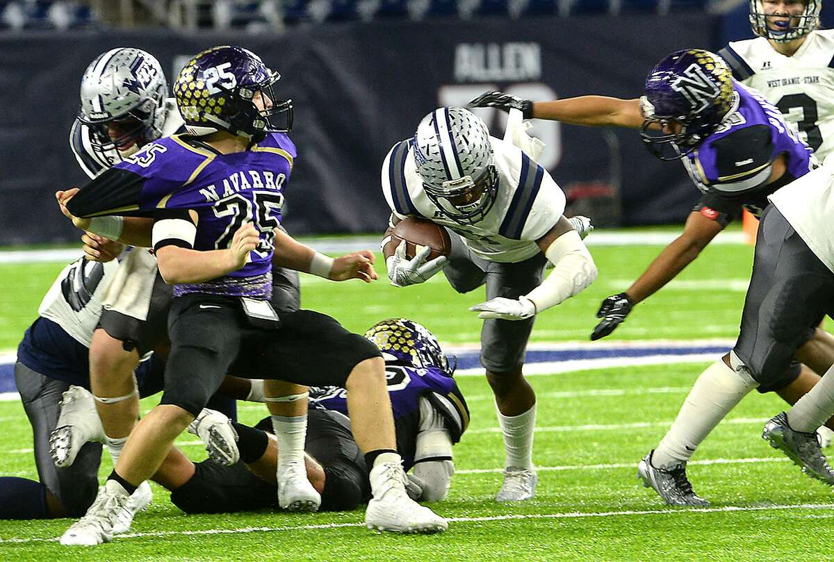 West Orange - Stark's Jerermiah Shaw dives over the pack of Navarro's defenders during Friday's Class 4A-II state semifinal match-up at NRG Stadium in Houston. Photo taken Friday, December 9, 2016 Kim Brent/The Enterprise