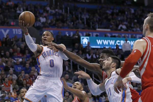 Oklahoma City Thunder guard Russell Westbrook (0) goes to the basket against the Houston Rockets during the second half of an NBA basketball game in Oklahoma City, Friday, Dec. 9, 2016. Houston won 102-99. (AP Photo/Alonzo Adams)