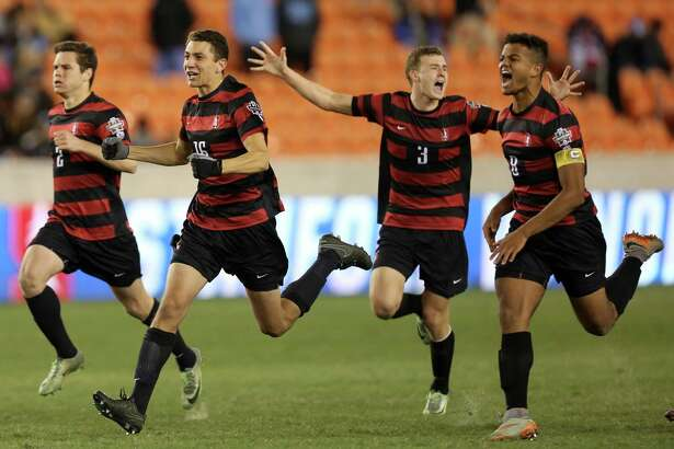 Stanford University players running toward their goalie Andrew Epstein (1) to celebrate as they win the 2016 NCAA soccer Men's College Cup semifinal game during PK at the at BBVA Compass Stadium Friday, Dec. 9, 2016, in Houston. Stanford beat UNC 10-9.