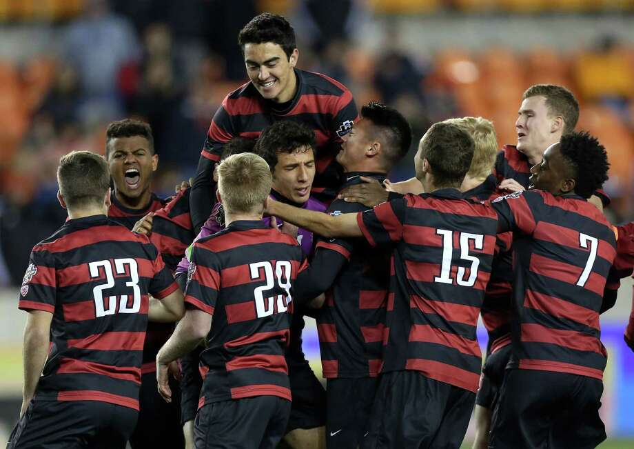 Stanford University players pile on their goalie Andrew Epstein (1) to celebrate as they win the 2016 NCAA soccer Men's College Cup semifinal game during PK at the at BBVA Compass Stadium Friday, Dec. 9, 2016, in Houston. Stanford beat UNC 10-9. Photo: Yi-Chin Lee, Houston Chronicle / © 2016  Houston Chronicle