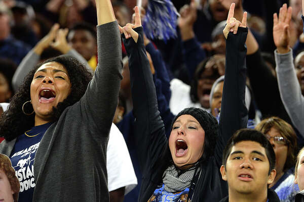 West Orange - Stark's fans celebrate as the Mustangs overpower Navarro during Friday's Class 4A-II state semifinal match-up at NRG Stadium in Houston. Photo taken Friday, December 9, 2016 Kim Brent/The Enterprise