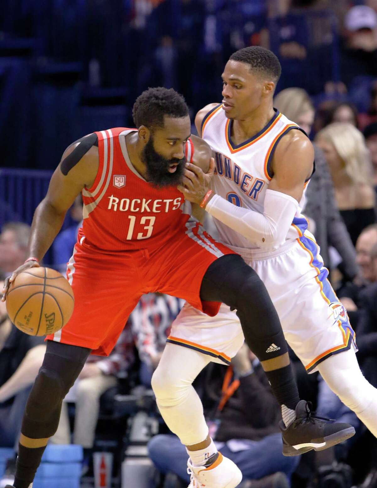Houston Rockets guard James Harden (13) is defended by Oklahoma City Thunder guard Russell Westbrook (0) on a drive to the basket during the second half of an NBA basketball game in Oklahoma City, Friday, Dec. 9, 2016. Houston won 102-99. (AP Photo/Alonzo Adams)