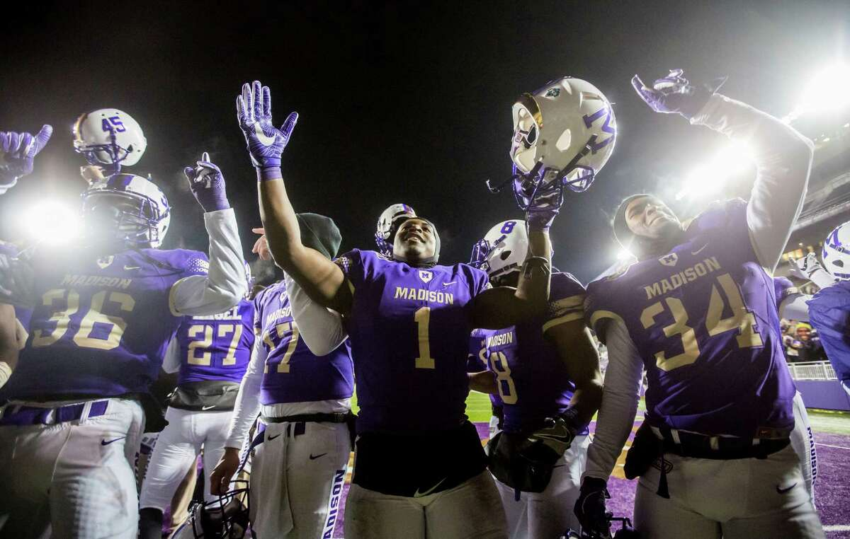 The James Madison football team celebrates their win over Sam Houston State after the NCAA college game in Harrisonburg, Va., Friday, Dec. 9, 2016. (Daniel Lin/Daily News-Record via AP)
