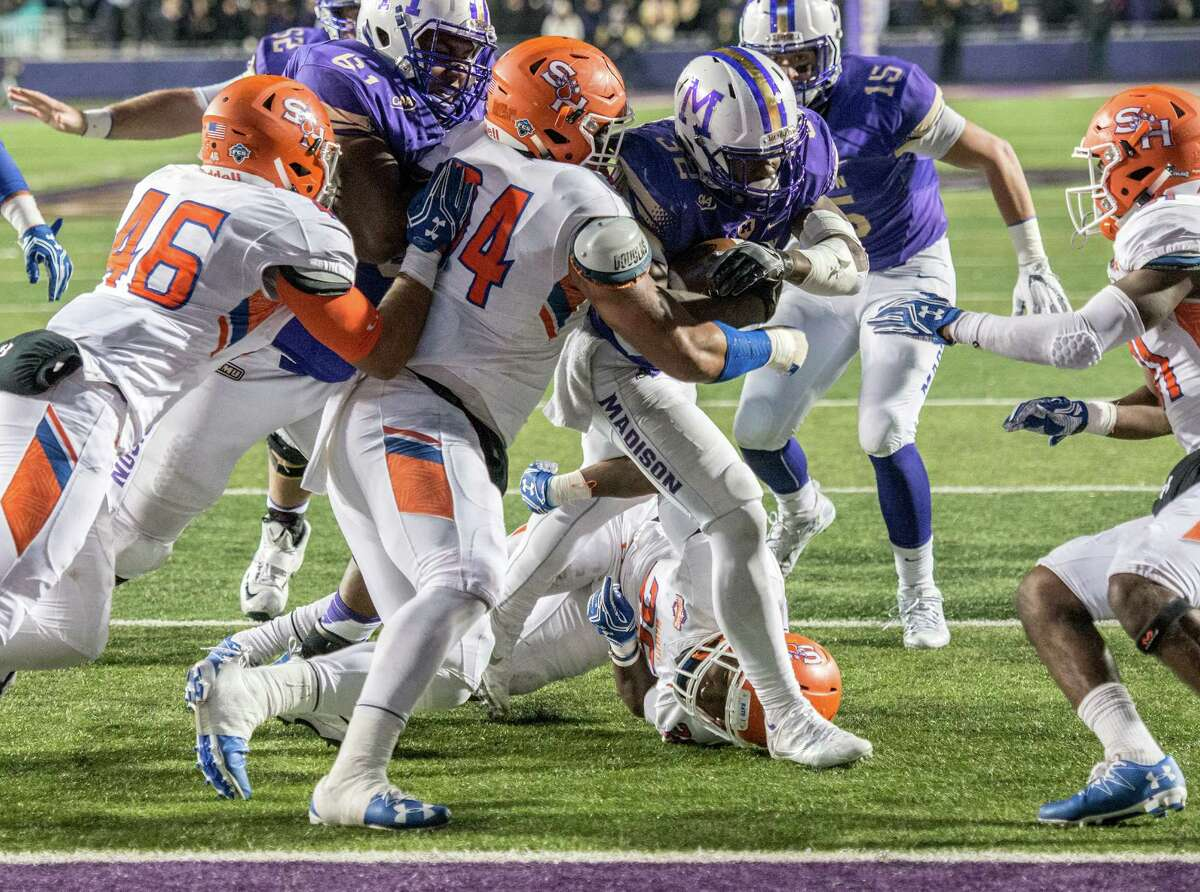 James Madison running back Khalid Abdullah (32) runs the ball for a touchdown during the second half of an NCAA college football game in Harrisonburg, Va., Friday, Dec. 9, 2016. (Austin Bachand/Daily News-Record via AP)
