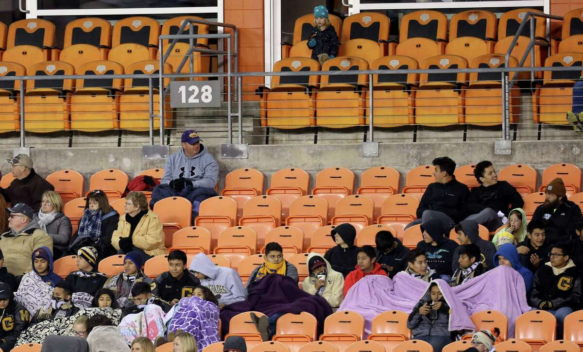 Audience are bundled up in the cold weather to watch University of North Carolina-Chapel Hill takes on Stanford University at the 2016 NCAA soccer Men's College Cup semifinal game at BBVA Compass Stadium Friday, Dec. 9, 2016, in Houston. Stanford beat UNC 10-9 at PK.